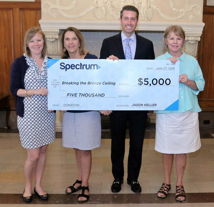 Charter-Spectrum presented a check in the amount of $5,000 to Breaking the Bronze Ceiling